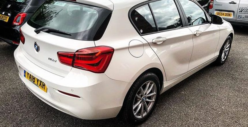 BMW 1 Series Hatchback in White being delivered to a new Car Subscription customer in London! Happy Motoring!
